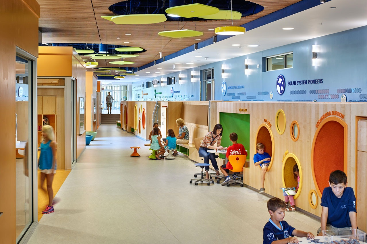 Most of Discovery's classrooms feature flexible furniture including height-adjustable tables, upholstered chairs, beanbags, and carpeted reading steps that provide students with flexibility.