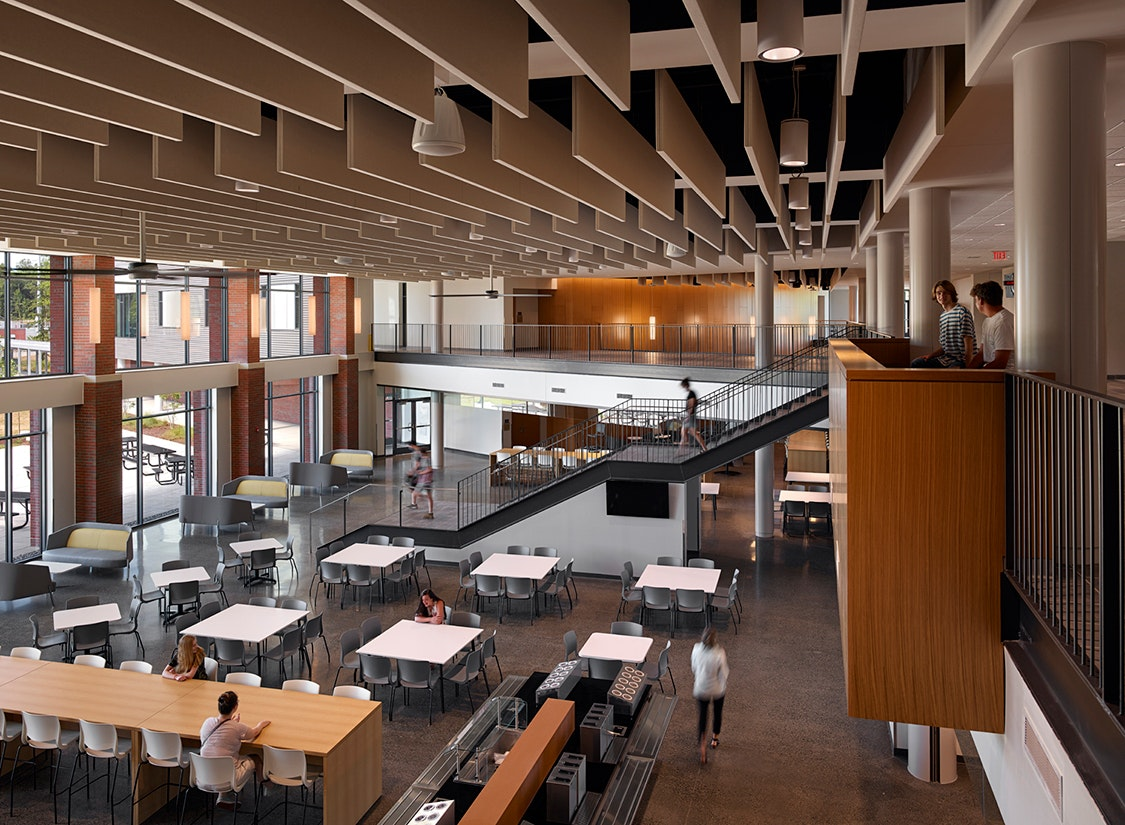 """The """"core"""" spaces of the building – such as the gym, performance hall, kitchen, dining commons, and library – were sized to accommodate the 2,000 student capacity, as these spaces are costly and difficult to expand in the future."""